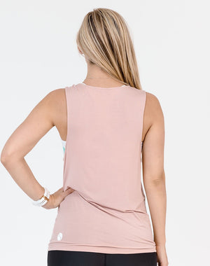 pregnant mum wearing a blush color breastfeeding top view from behind