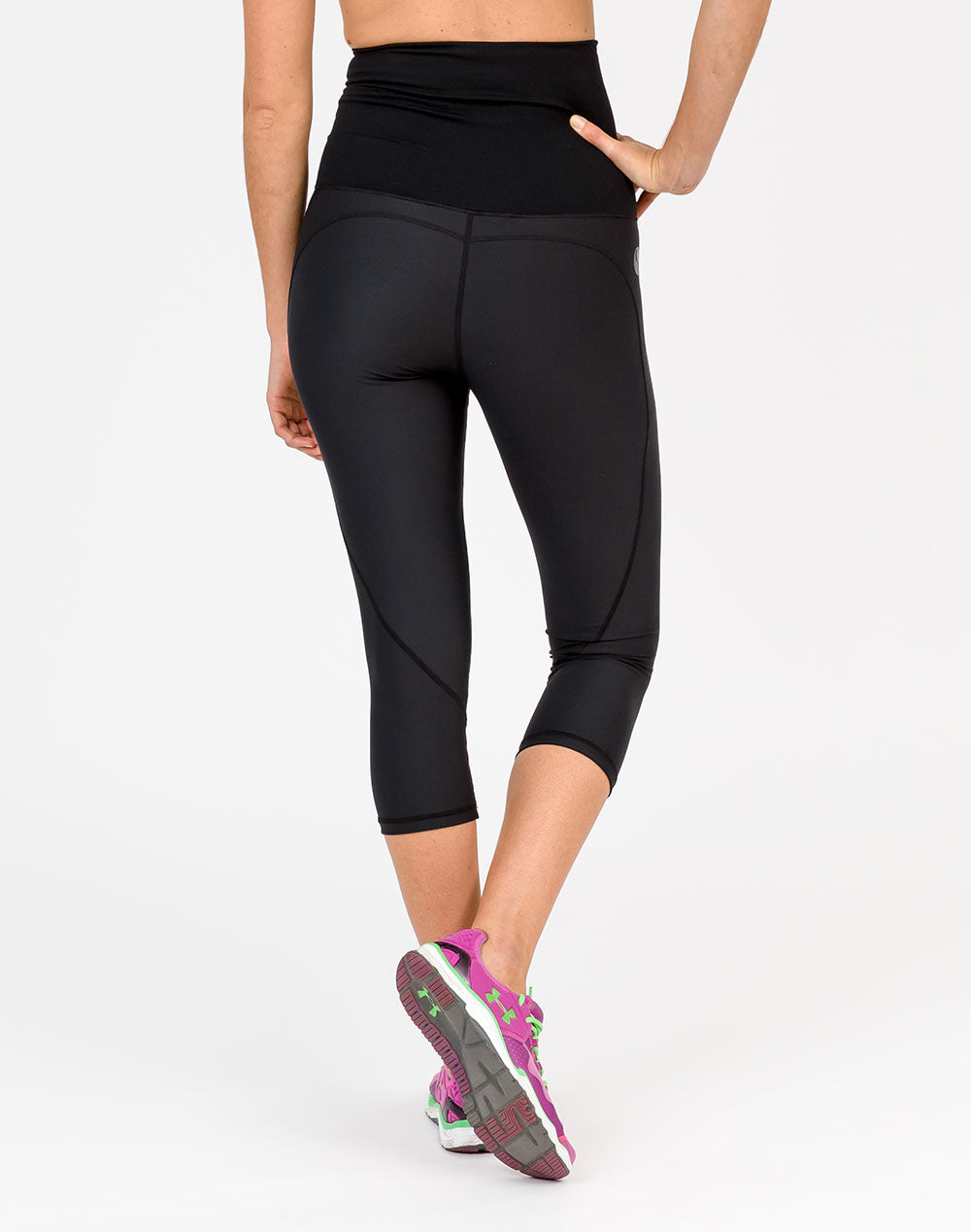 back view of a mom wearing black 3/4 maternity leggings and running shoes