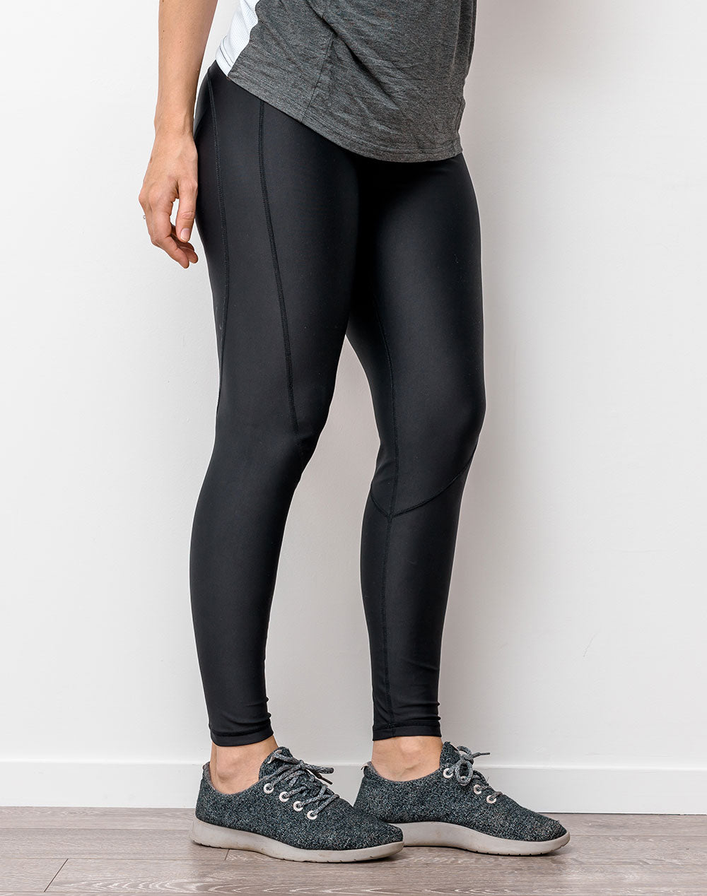 active mom wearing black full length maternity leggings to yoga