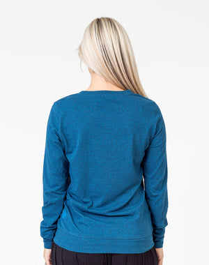 back view of a mom in a navy maternity top with long sleeves