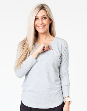 front view of a mom wearing a gray maternity top with long sleeves