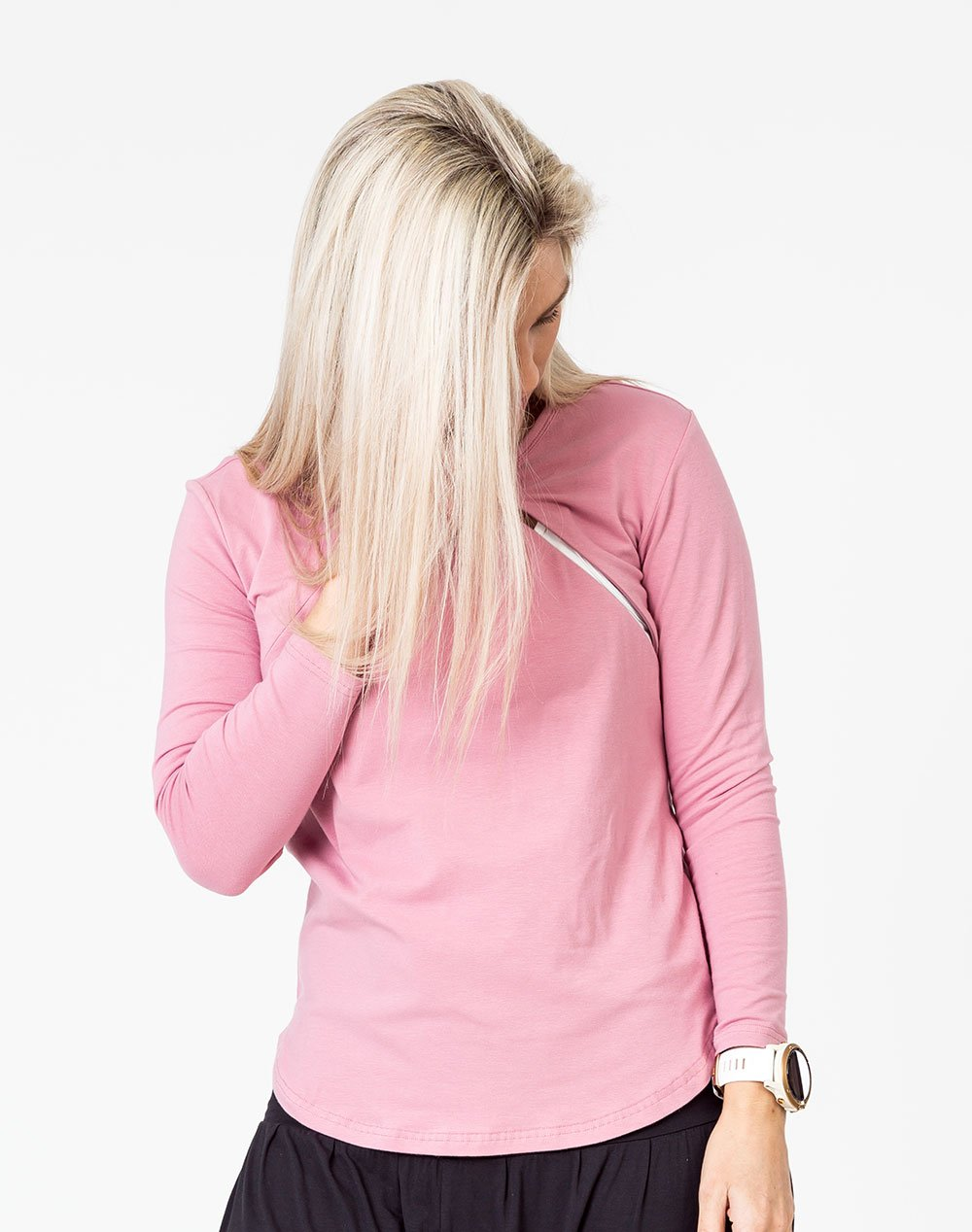 front view of a mom wearing a pink maternity top with long sleeves and invisible zips