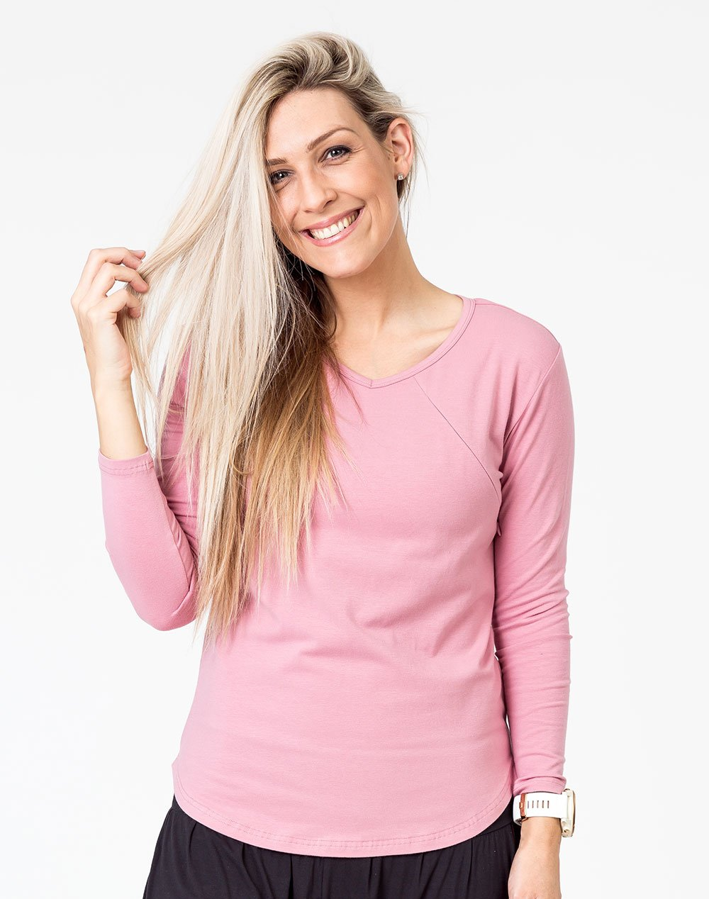 active mom wearing a pink maternity top with long sleeves and invisible zips for breastfeeding