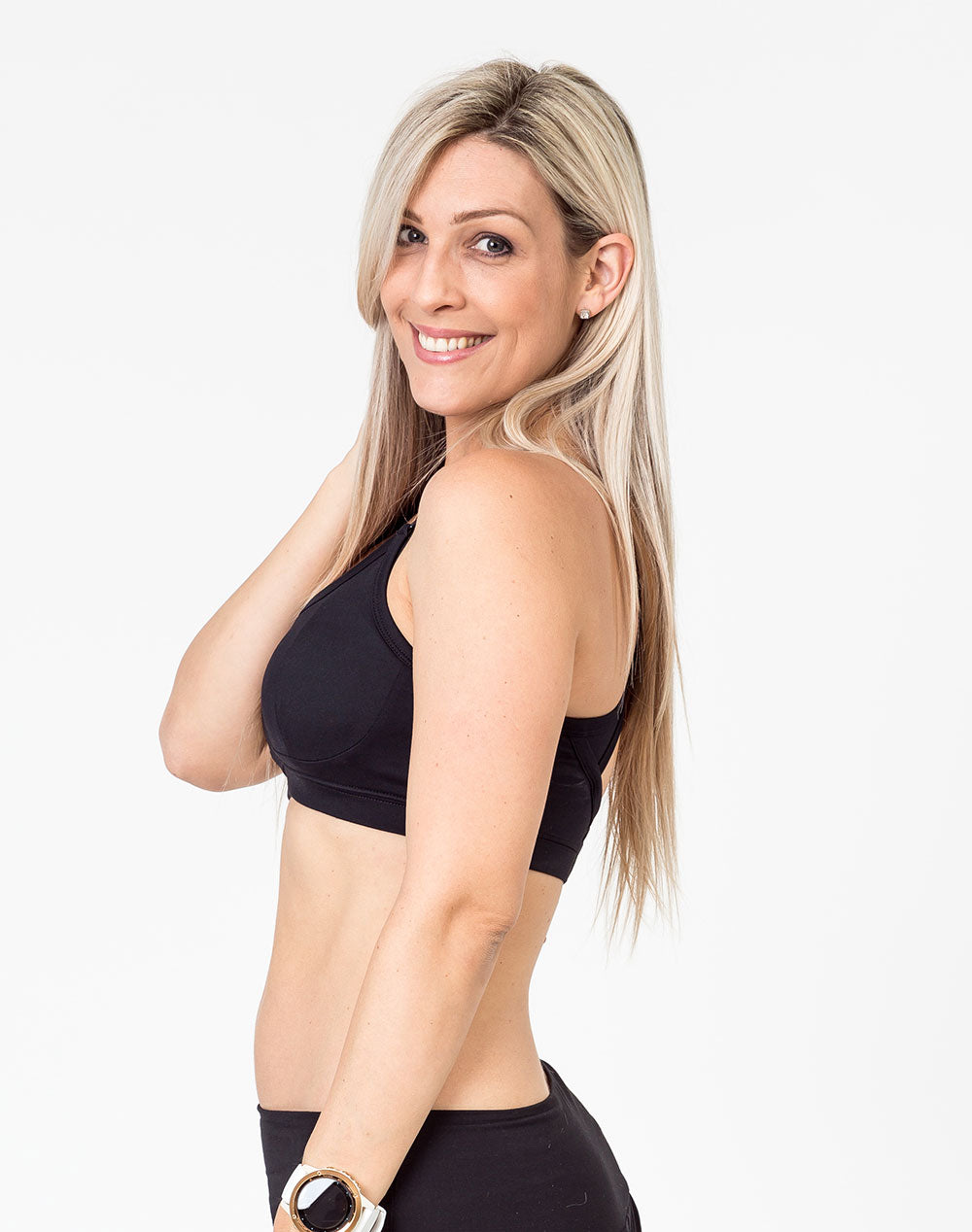 mom wearing a black racerback nursing bra side view