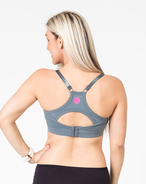 back view of a mom wearing a gray racerback nursing bra