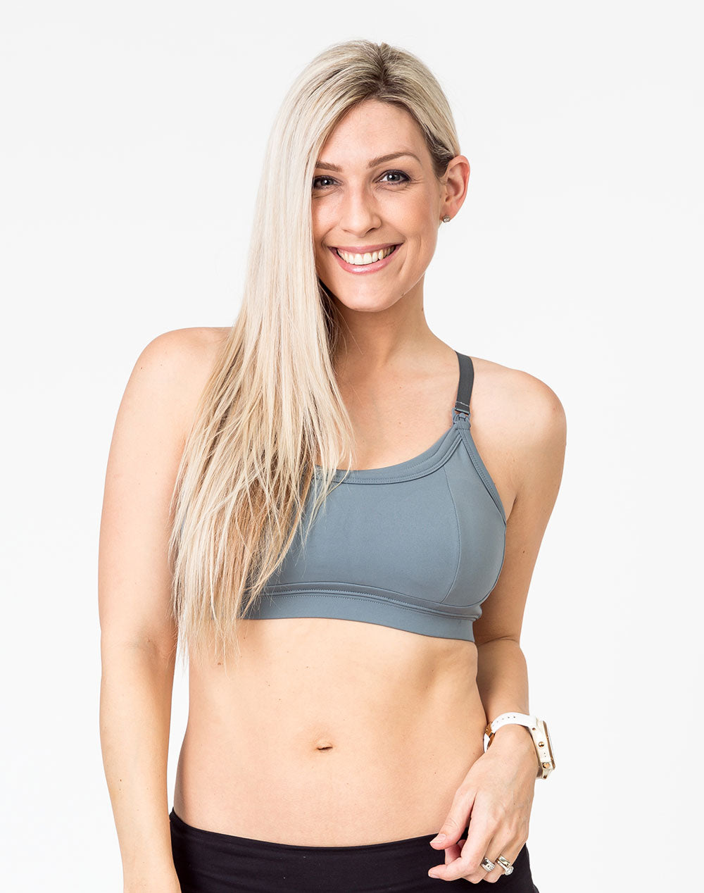front view of a mom wearing a gray racerback nursing bra