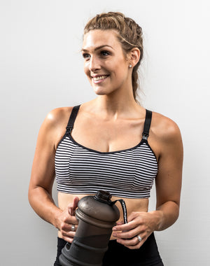 active mom training in a black and white striped maternity activewear bra
