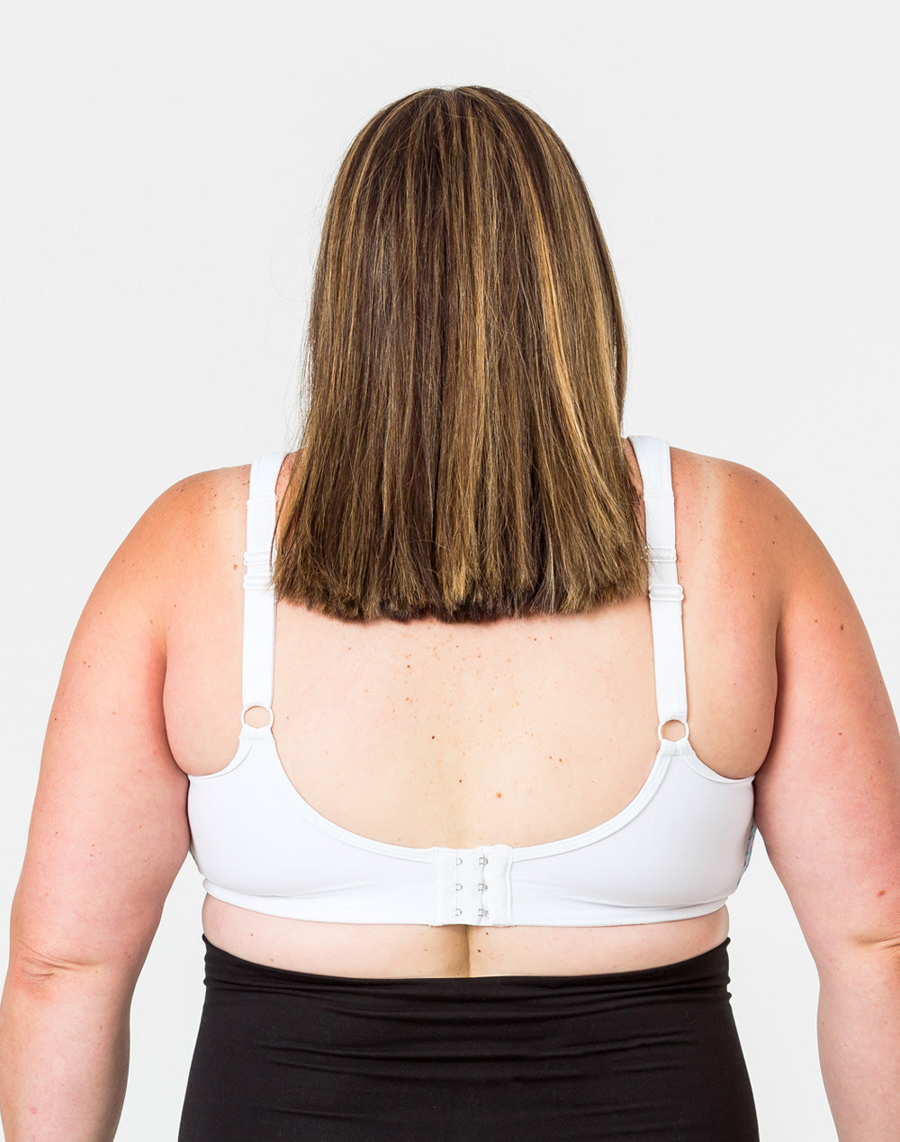 back view of a mom wearing a plus size nursing bra with thick bra straps to provide optimal support
