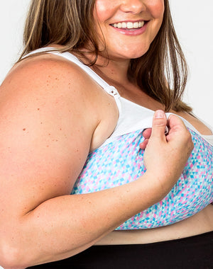 close up of an expecting mom wearing a plus size nursing bra with one drop down cup unclipped