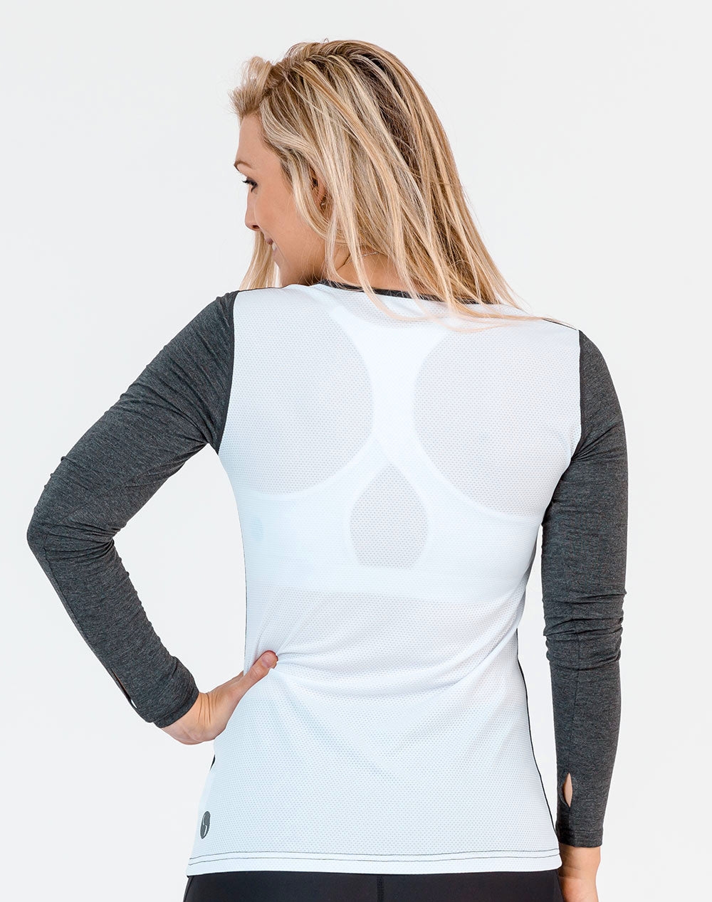 side view of a mom wearing a gray and white maternity top with long sleeves
