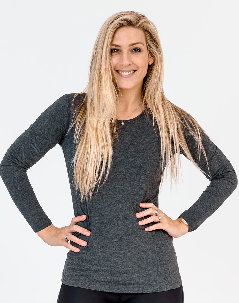 front view of an active mom wearing a gray maternity top with long sleeves
