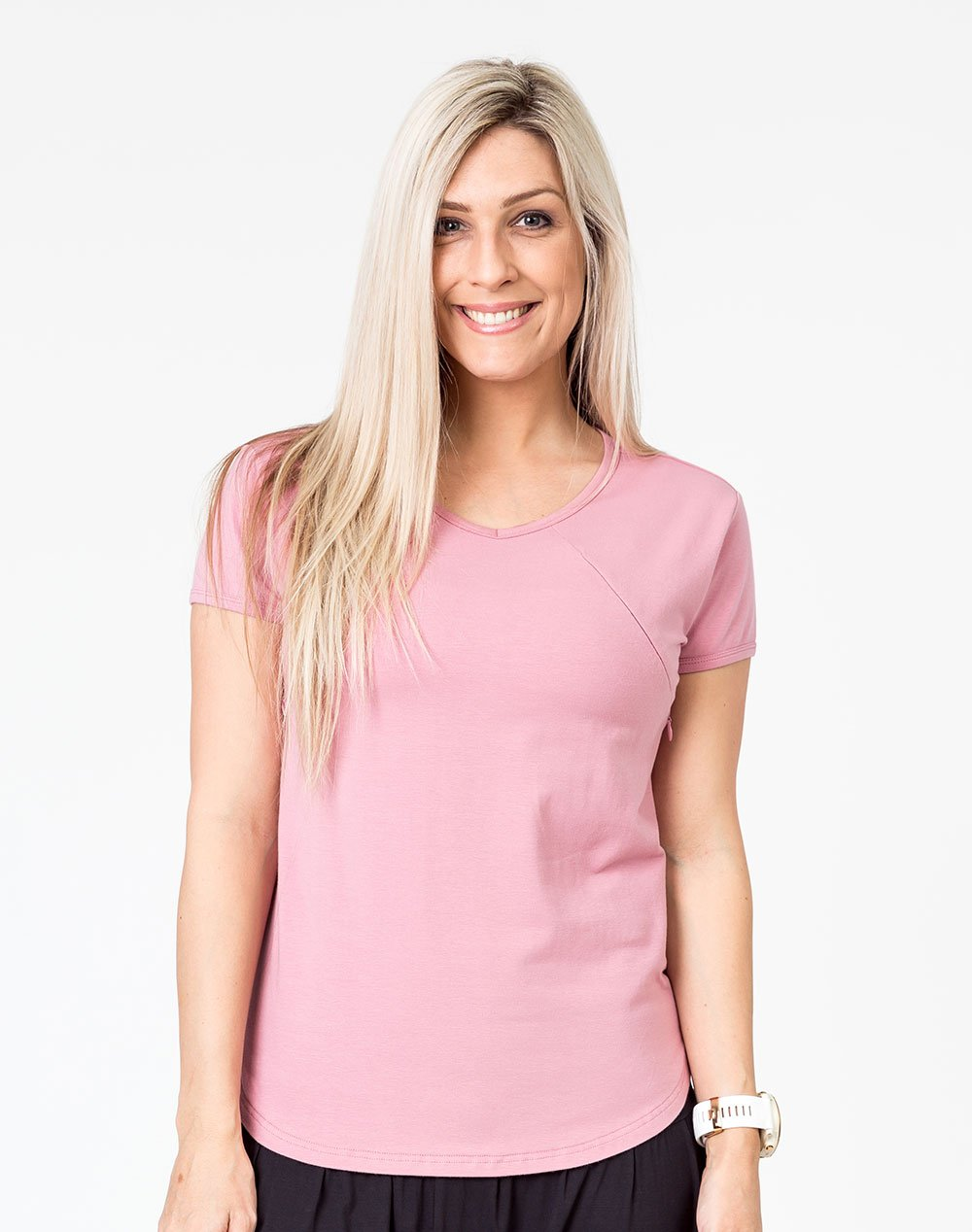 active mom wearing a pink scoop breastfeeding t-shirt