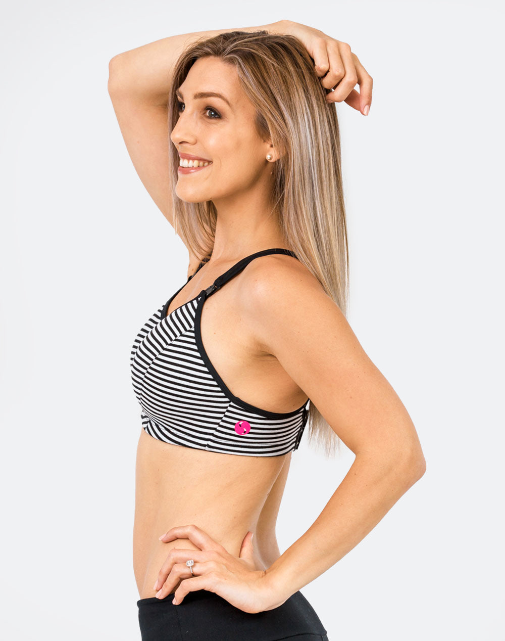 mom in a striped ultimate bra nursing sports bra side view showing Cadenshae logo
