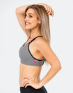 mum in a striped ultimate bra nursing sports bra side view showing Cadenshae logo