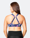 back view of active woman wearing a nursing sports bra in racerback