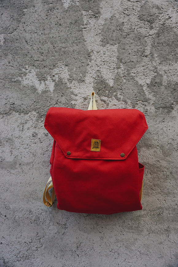 red canvas school and travel backpack