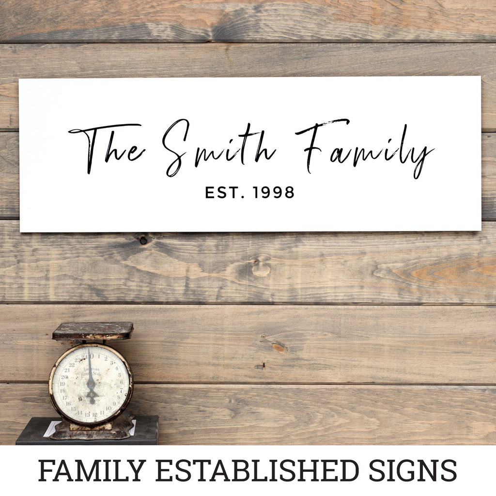 Bright white family established sign showing the history of your household by year.