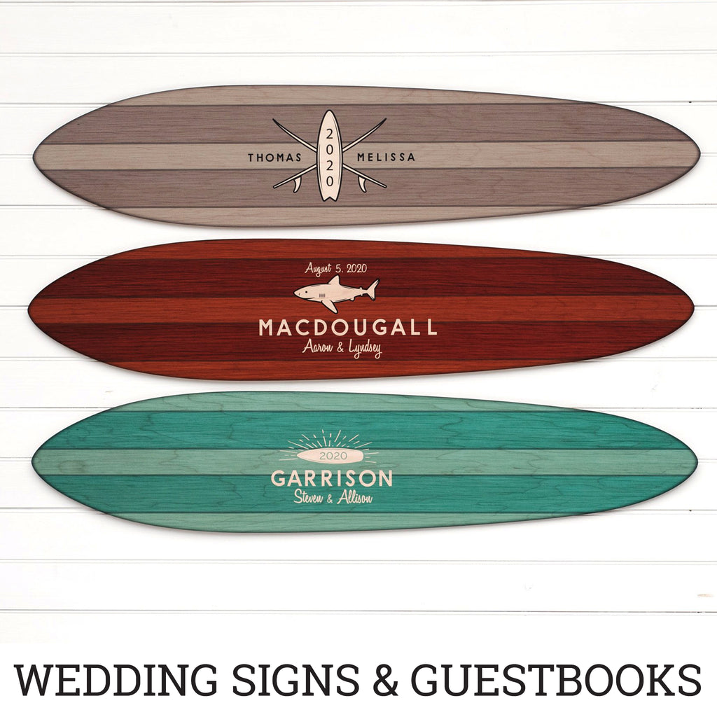These jewel tone surfboards are our alternative wedding guest books and are personalized with year, name and logo.