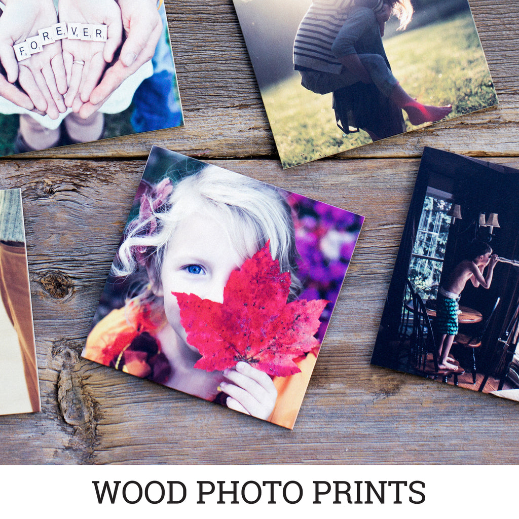 Printed family photos on wooden boards that capture outdoor memories with loved ones.