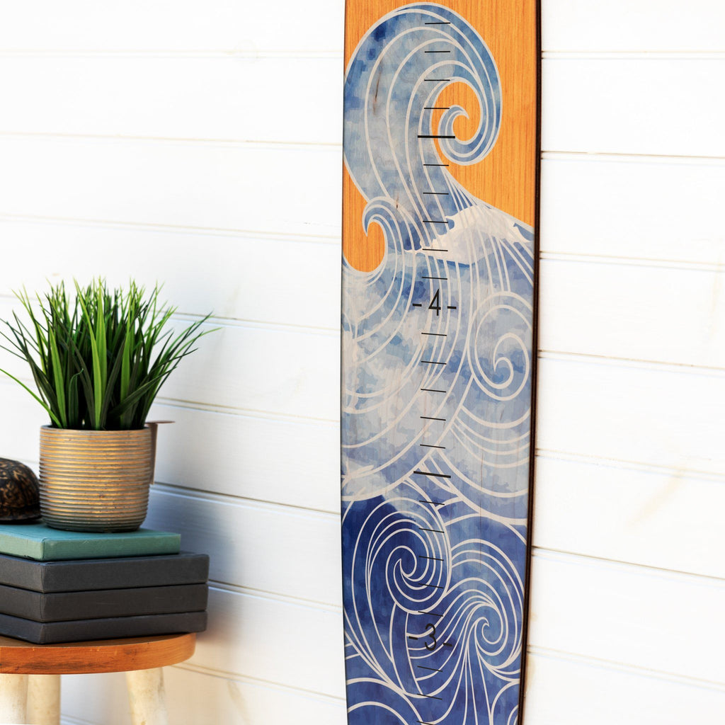 Paired with a plain white wall in your home, this dreamy wave longboard growth chart adds a great touch of the ocean to any room. Perfect for a kid's room!