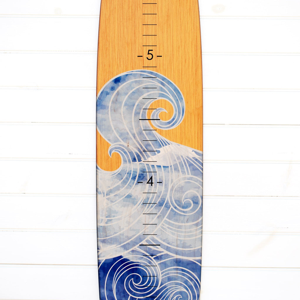 A detailed view of the wave print on our longboard growth chart, the numerical markings really stand out against the light blue colored swirls and lines.