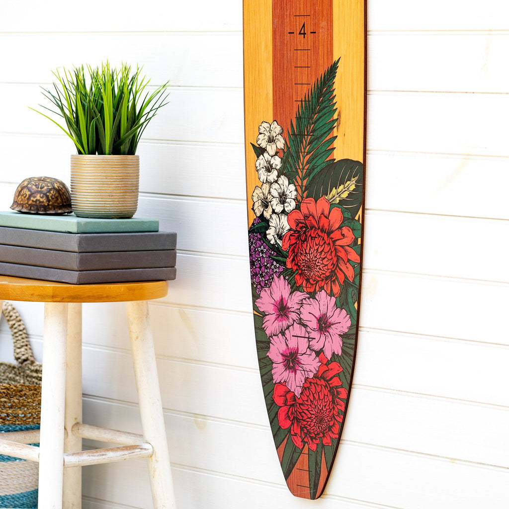 Paired with a plain white wall in your home, this floral longboard growth chart adds a bright pop of pink and red to any room. Perfect for a kid's room!