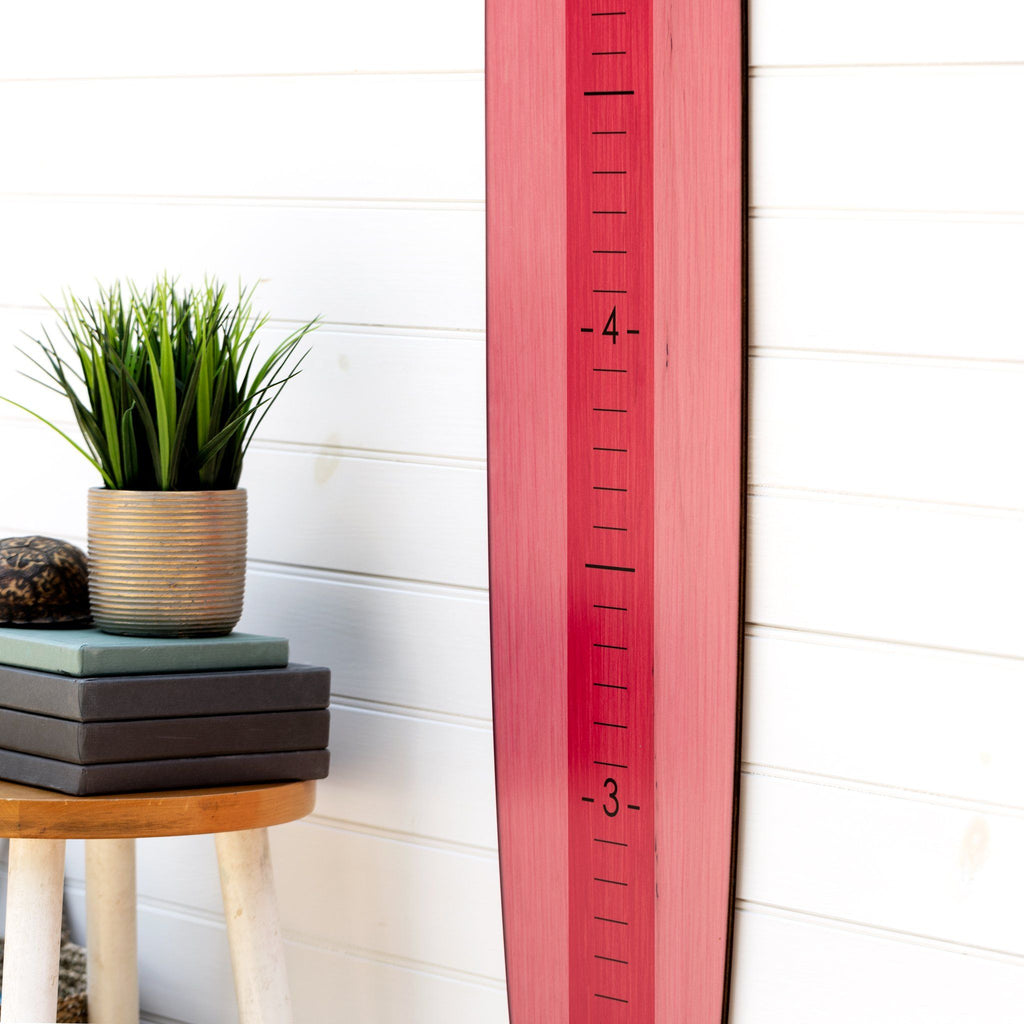 Paired with a plain white wall in your home, this bright pink longboard growth chart adds a bright pop to any room. Perfect for a kid's room!