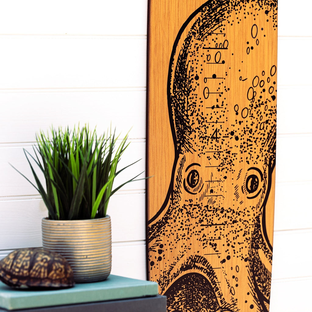 The demarcations are large and easy to read on this octopus longboard growth chart.