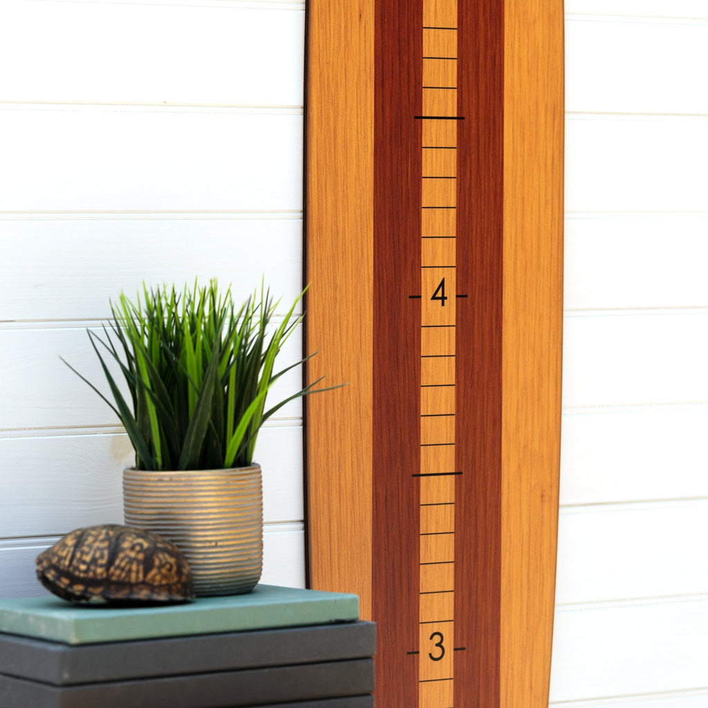 The demarcations are large and easy to read on this wood longboard growth chart.