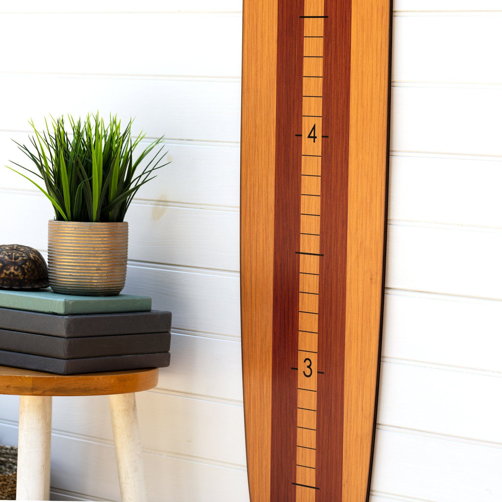 Paired with a plain white wall in your home, this wood finish longboard growth chart becomes a neutral staple to any room. Perfect for a kid's room or another spot in your home!