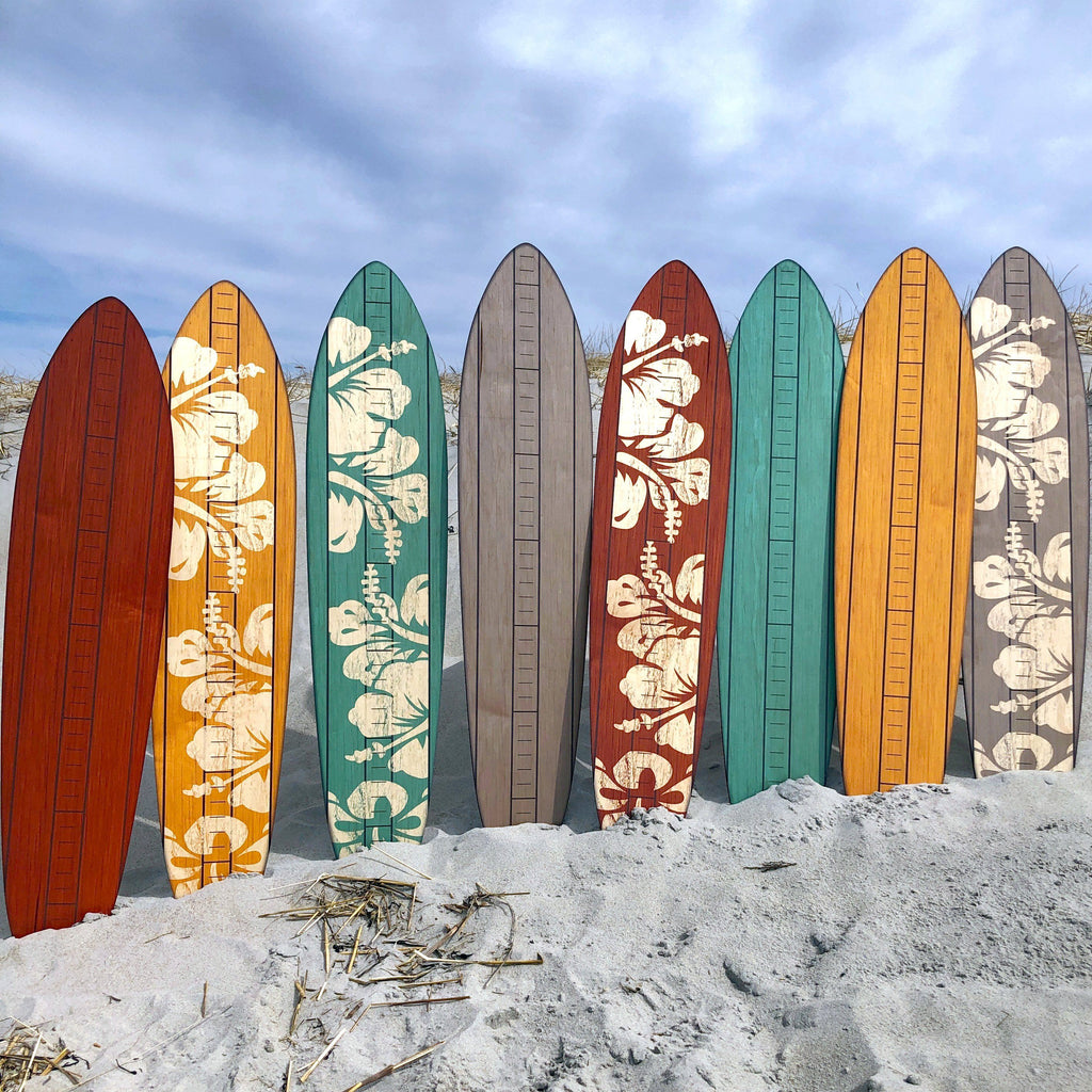Check out the entire collection of these primary vintage surfboard growth charts including rusty brown, blonde, teal and gray in both a solid or hibiscus finish.