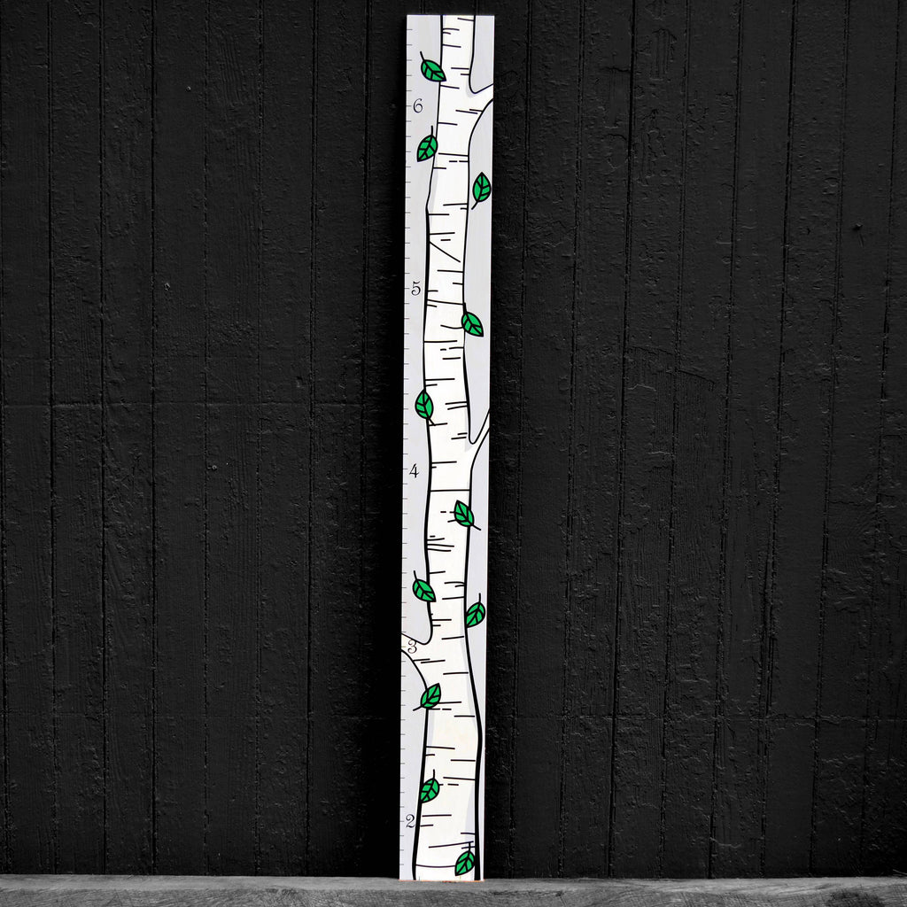 We offer a narrow alternative to our birch tree wooden height chart, this option has green leaves.