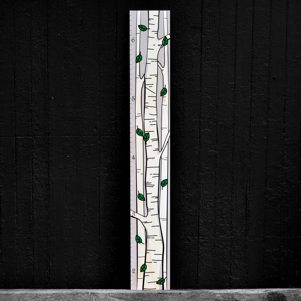 This multicolor wide birch tree wooden growth chart leaves lots of room for documenting the heights and memories of your children.