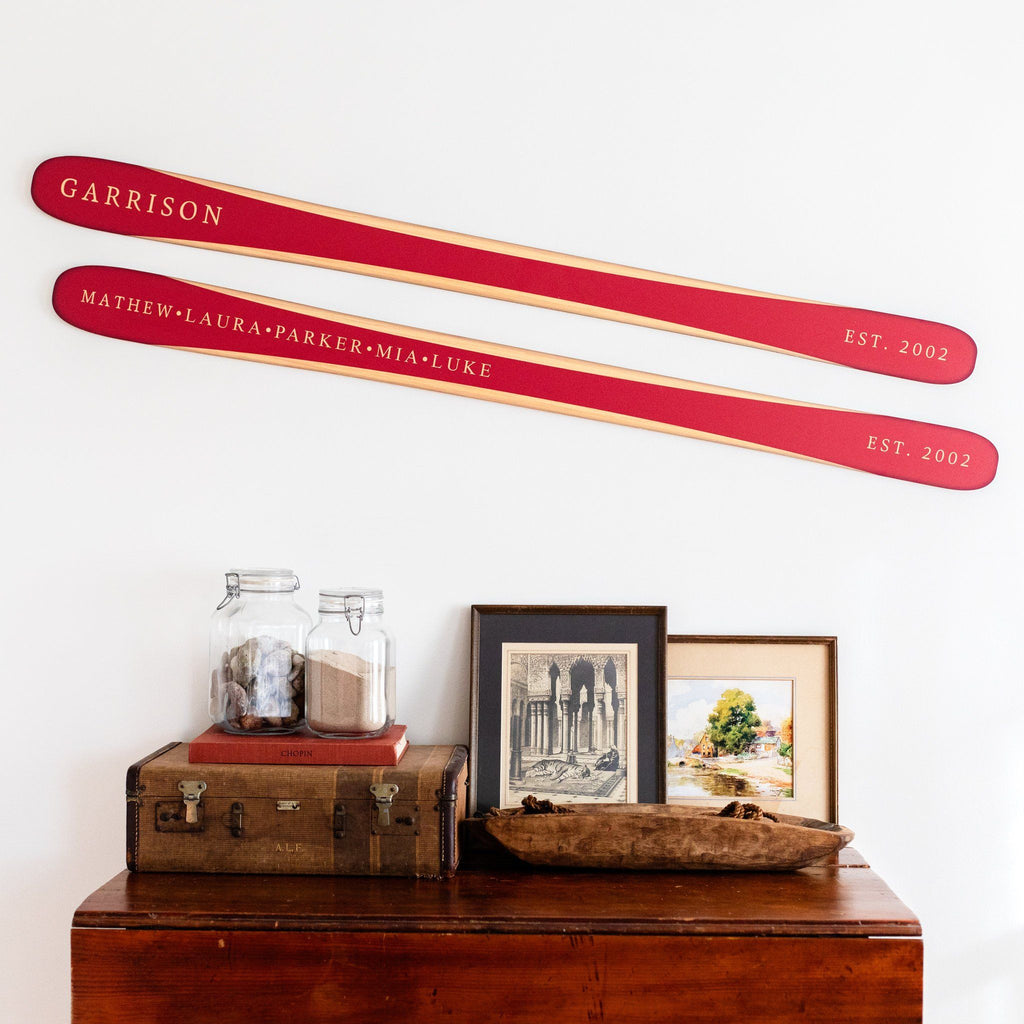 Our family established wooden skis in bright red displayed on a wall to show sizing and design ideas for an interior.