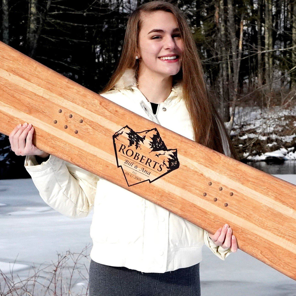 Our model Evelyn holding a customized alternative wedding guest book snowboard in the two-tone blonde finish.