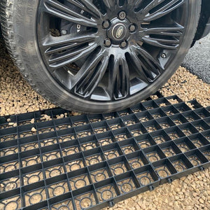 Interlocking plastic gravel mats for driveways