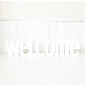 """Welcome"" - thick letters, trendy font"