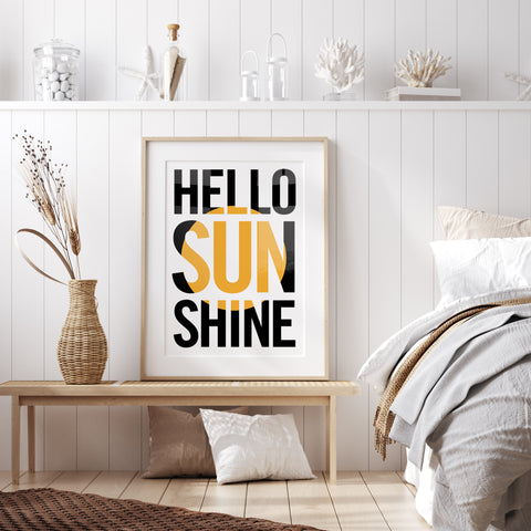 hello sunshine typography print sits on a wooden bench in a scandi style bedroom with a jute rug and seagrass basket with pampass