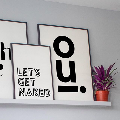 Floating shelf with three monochrome typography prints from Rocket Jack