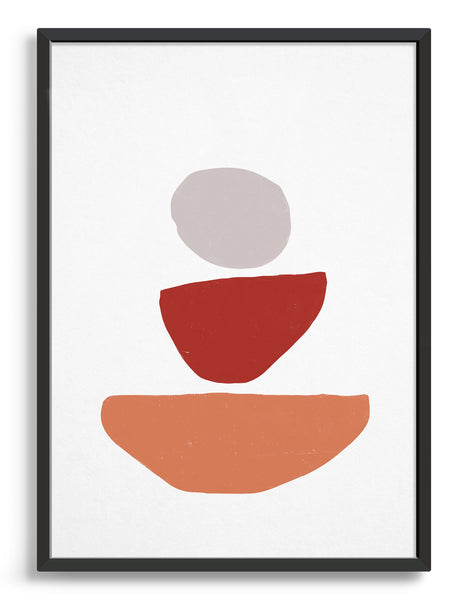 Abstract art print of what looks like decreasing sized stones stack on top of each other. Large orange semi circle on the bottom, red semi-circle and then neutral grey circle on top on a white background