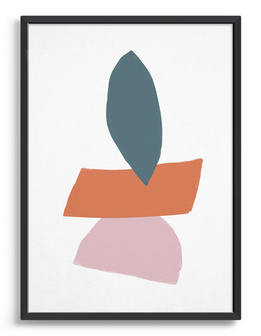 Nature inspired abstract print of stacked stones with dark grey oval stone on top of orange rectangular stone on top of pink semi circle stone