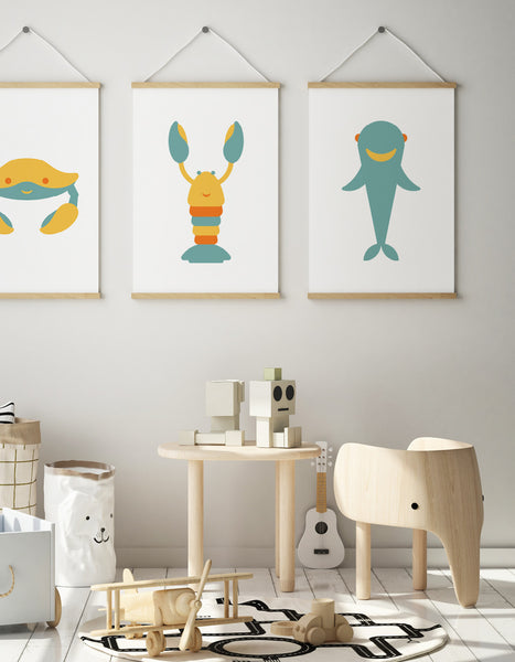 Kids playroom with desk, cute elephant chair and a trio of three art prints on the wall showing a crab, lobster and shark
