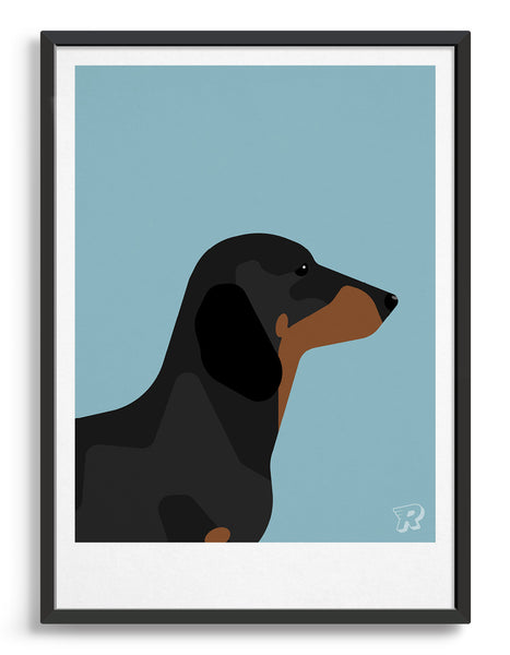 framed art print of a sausage dog in profile against a light blue background
