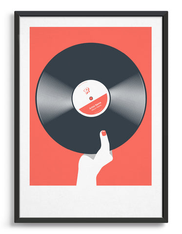 framed art print of a black vinyl record held in a hand with red nails against a living coral background