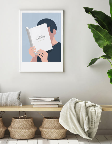 Minimal art print depicting a white person with their head in a book, reading. The book cover can be personalised, this one has a simple design