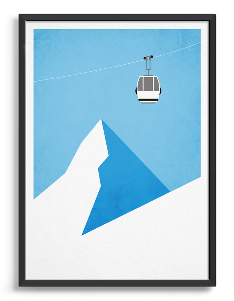 A ski gondola going through the air above a mountain peak
