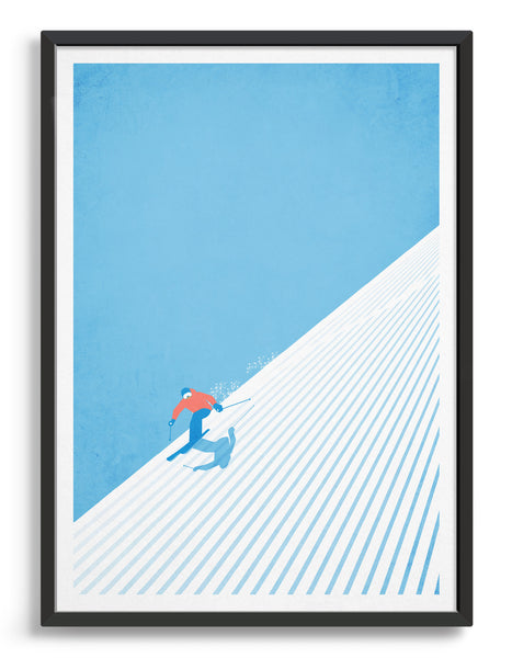 Skier carves down the mountainside with blue sky behind