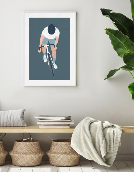 Lifestyle image showing the cyclist art print on the wall in a hallway with scandi decor