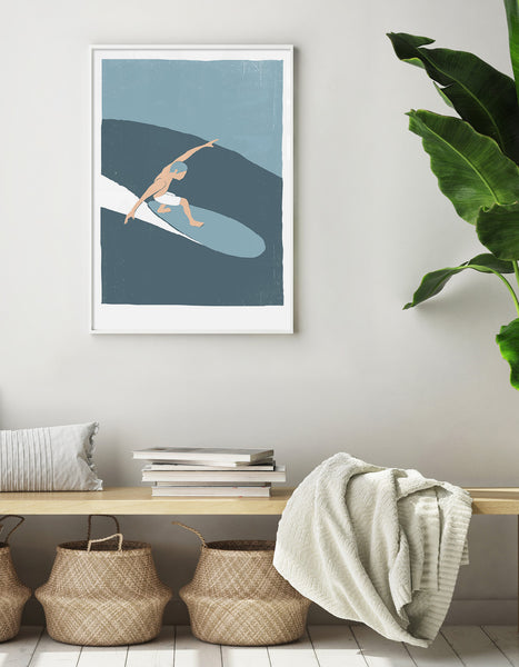 Lifestyle image depicting the surfer print on the wall above a hallway bench with storage baskets and books