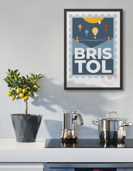Lifestyle image depicts the customisable Bristol stamp print featuring the suspension bridge and hot air balloons against a grey & yellow background
